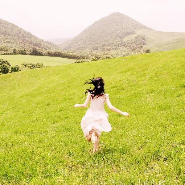 Girl running away in dress