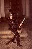 ведьмочка-металлистка с метлой